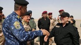 На фото справа: премьер-министр Ирака Хейдар аль-Абади