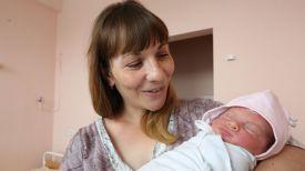 Марина Бондаренко с новорожденным ребенком