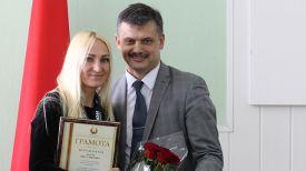 Капитан белорусской сборной Рита Батура и Сергей Ковальчук. Фото Министерства спорта и туризма