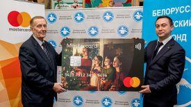 Александр Трухан, директор Белорусского детского фонда и Вадим Головчиц, директор Mastercard в Беларуси