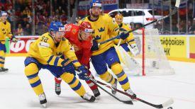 Во время матча Россия - Швеция. Фото IIHF