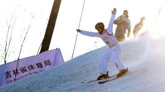 Ци Гуанпу совершает победную попытку. Фото Синьхуа - БЕЛТА