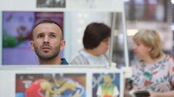 Яркие моменты олимпийской истории представлены на фотовыставке НОК в Минске