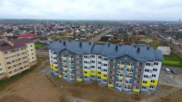 Построенный Михаилом Гуцериевым многоквартирный дом передан в собственность Любани